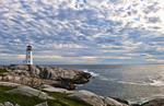 Beautiful sky and lighthouse in Peggys Cove in Nova Scotia Canada and rocks