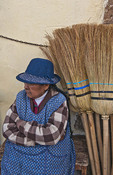 Traditional woman in costume selling brooms in Cuzco Cusco Peru