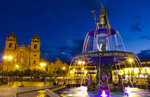 Beautiful colorful night exposure of fountain Main Square in center of Cusco Cuzco Peru in South America