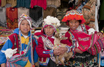 Colorful children in traditional clothes and hats in small town of Pisaq Peru