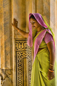 Beautiful graphic walls with colorful Hindu gentle woman posed at Amber Fort temple in Rajas-than Jaipur India