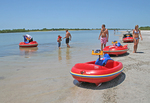 People with beach toys Tigertail Beach Marco Island Florida
