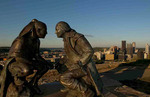 Statue of George Washington trading with Indians in Pittsburgh Pennsylvania and the Three Rivers taken from Mt Washington showing skyline