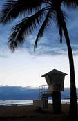 Hawaii Honolulu  twilight of lifeguard stand and palm trees on Waikiki Beach