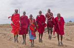 Kenya Africa Amboseli Masai men in red costume  dress and beads in Amboseli National Park
