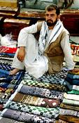 Carpet salesman at market in Afghanstan