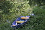 Blue rowboat at smal pond