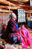 Susie Yazzie, Navajo Weaver, in her traditional hogn, Navajo Land, Monument Valley, Navajo Tribal Park