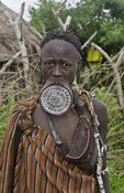 Mago National Park Ethiopia Africa Mursi tribe women Lower Omo Valley  with clay pots in lips tradition tribal wild pottery