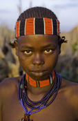 Turmi Ethiopia Africa Lower Omo Valley village with teenage Bena tribe girl portait at sunset