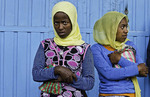 Addis Ababa Ethiopia local two young women against blue door with scarfs