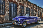 Cojimar Havana Cuba old Classic 1953 Chevy against worn stone wall in Ernest Hemingway city of Cojimar