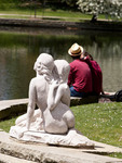 Young couple sitting at the lagoons in front of the Cleveland Museum of Art