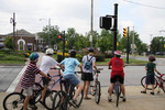 Large group of bike riders wait to cross the street  in Cleveland, Ohio