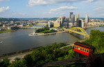 Pittsburgh Pennsylvania from Mt Washington hill looking at Golden Triangle and the city skyscrapers where the three rivers and red incline cars coming up the mountain