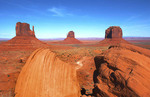 Monument Valley Utah desert mittens in panoramic of Western landscape at sunset