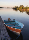 Small power boat for fishing at dock in Canada