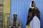 Addis Ababa Ethiopia Capital Africa local man and woman against blue door with scarf and hat