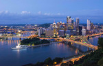 Pittsburgh Pennsylvania skyline from Mt Washington of downtown city and rivers at Golden Triangle at night exposure of Three Rivers