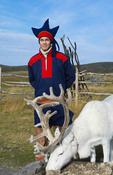 Honningsvag Norway cruise Hurtigruten Sami Tribal man in costume with reindeer at North Cape Northern most place in Europe