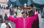 Marrakech Morocco traditional snake charmers in Old Medina with snakes in pink robe