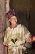 Morocco Sekoura small village Berber homes and woman portrait in her poor home