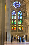 Barcelona Spain Le Sagrada Familia Church stain glass interior of Gaudi designer Basilica church pillars started in 1882 tourists looking up from floor