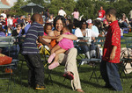 Black family enjoying an outdoor concert in the summer time at Wade Wednesdays
