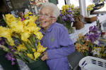 Female senior buying flowers at an outdoor market in Roanoke, Virginia