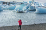 Iceland Jokulsarlon glaciers and icebergs on lake lagoon with photographers on edge of Vatnajokull National Park in Southeast Iceland