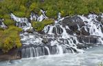 Iceland Hraunfossar Lava Falls in Reykholt Valley in West Iceland many falls along cliff from glacier Langjokull