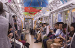 Tokyo Japan crowds subway car with locals going to work in crowded transportation of train cabin