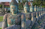 Line up of statues of buddhas in downtown  Siem Reap Cambodia in Asia at sunset