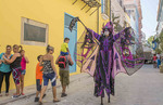 Old Havana Cuba Habana woman on stilts and costume on streets with tourists in Old City Cuba