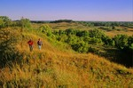 Couple hiking the tallgrass prairie at Sheyenne National Grassland, near Lisbon, North Dakota, AGPix_0080
