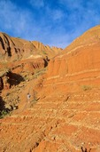 Hiker on trail among cliffs at Palo Duro State Park near Amarillo, Texas, AGPix_0167