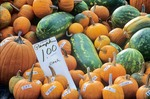 Pumpkins and melons for sale at Saturday Morning Farmers Market in Downtown Des Moines, Iowa, AGPix_0169