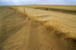 Dust drifts around fence line during Great Plains drought in Cimarron County, Oklahoma, AGPix_0171