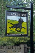 Pub sign for the Black Horse in the Cotswold village of Naunton, Gloucestershire, England, AGPix_0199