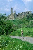 Walker on road below Village of Baschi, Tevere Valley, southeast of Orvieto, Umbria, Italy, AGPix_0203
