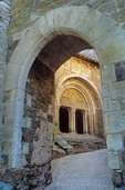 Church of St. Pierre viewed through fortified arch at  Carennac in the Dordogne Valley of France, AGPix_0204