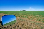 Vast horizons of Great Plains ,view in rearview mirror along Highway 64, near Alva, Oklahoma, AGPix_0260