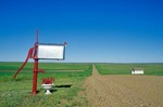 Ranch mailbox and along country road with old country school house on Great Plains near Bison, South Dakota, AGPix_0261