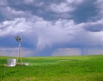 Windmill on prairie with rain falling from distant thunderstorm, south of Agate, Nebraska, AGpix_0299