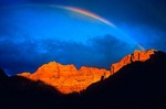 "Rainbow arcs over sandstone walls of ""The Watchman"" at Zion National Park, Utah, AGPix_0322"