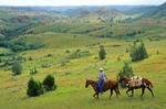 Cowboy with packhorse, riding in Badlands near Medora, North Dakota, AGPix_0324