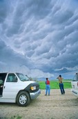 Storm chasers viewing stormy sky in Tornado Alley region of Great Plains, near Alliance, Nebraska, AGPix_0343