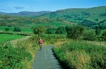 Walking through English countryside on the Dales Way in Lake District National Park, near Staveley, Cumbria, England, AGPix_0348