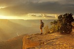 Hiker Stands on Grand Canyon Rim near Hopi Point at summer sunset, Grand Canyon National Park, Arizona, AGPix_0355