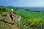 Hiker on footpath above village of Puligny-Montrachet in the Cotes de Beaune, wine region, Puligny-Montrachet, Burgundy, France, AGPix_0373